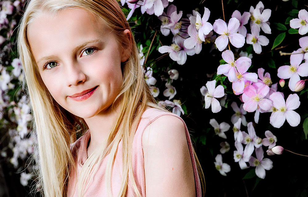 blonde girl with pink flowery background