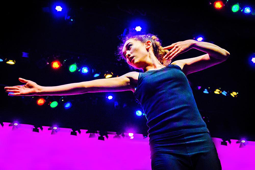 dancer onstage multicoloured lighting