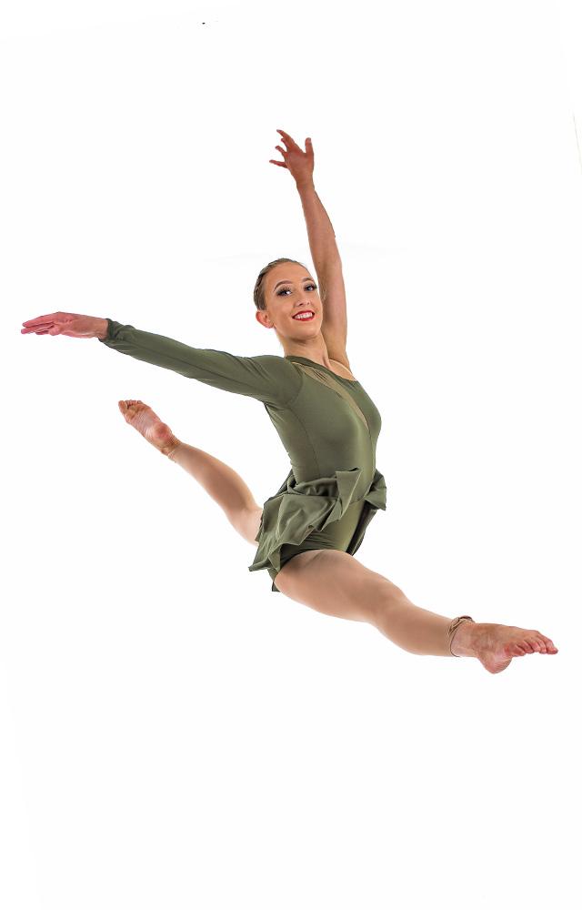 dancer in green costume leap