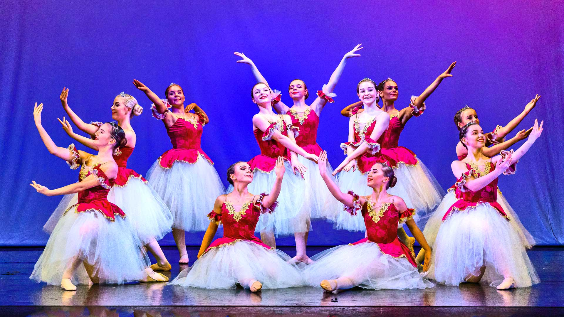 dancers in romantic tuts with red bodice