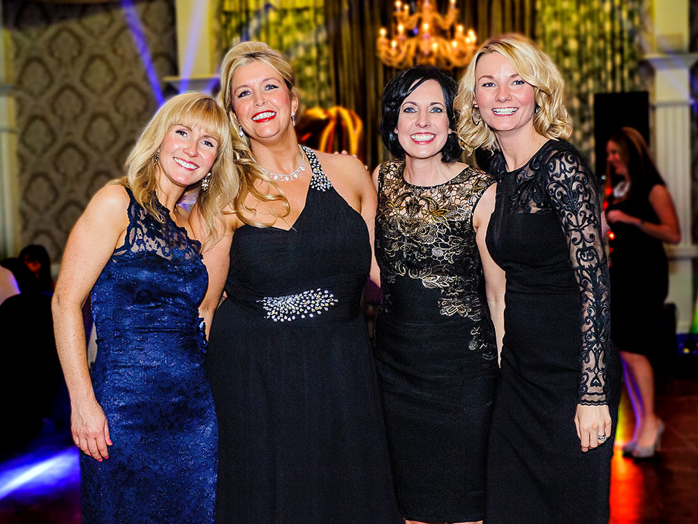 women in evening wear at party