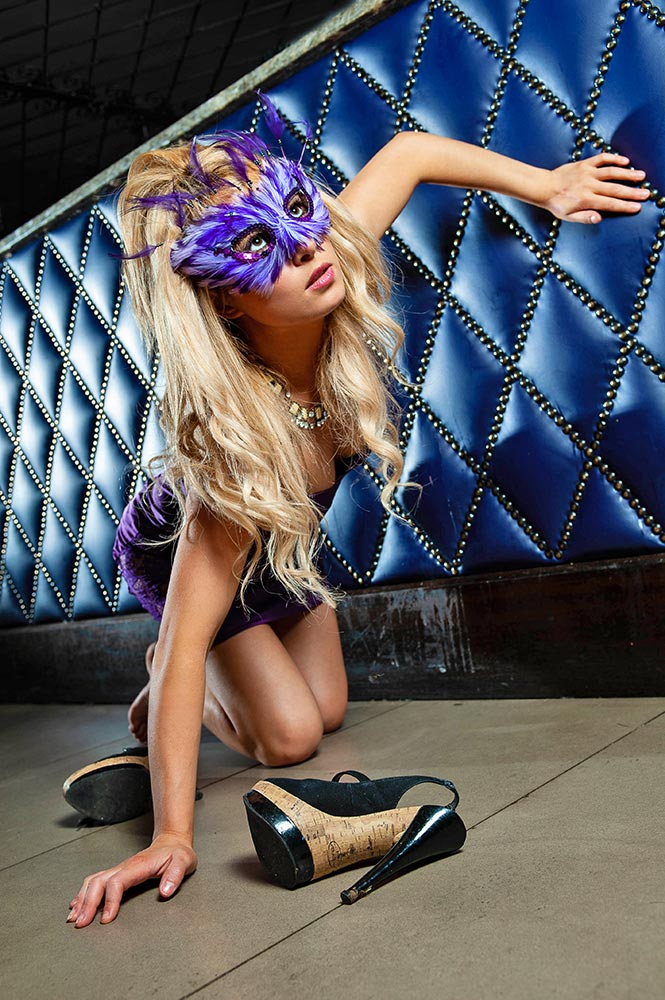 fashion model with masquerade mask in nightclub