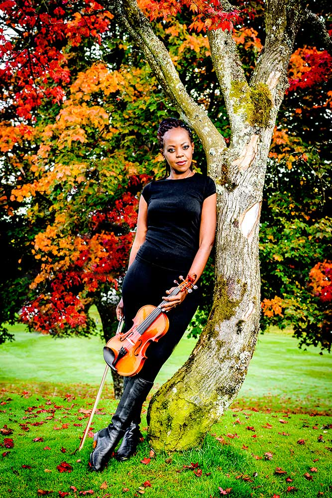 violinist in outdoor autumn scene