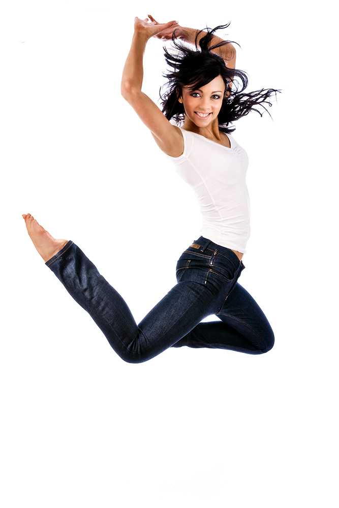 dancer in jeans and white top leaping into the air